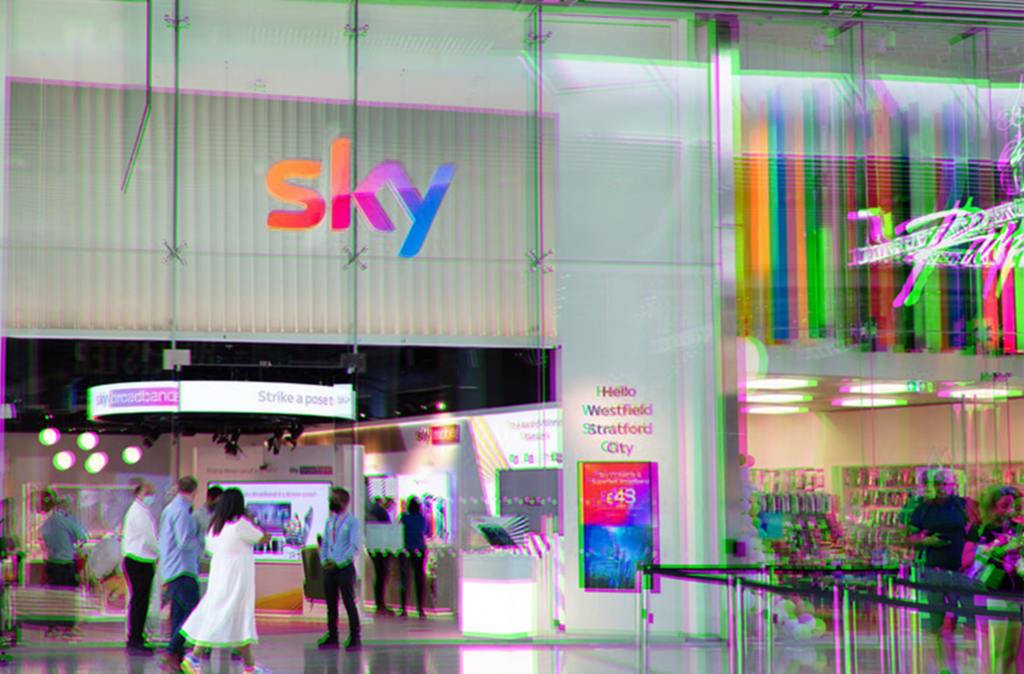image of a sky store in a busy chopping centre next to a paperchase